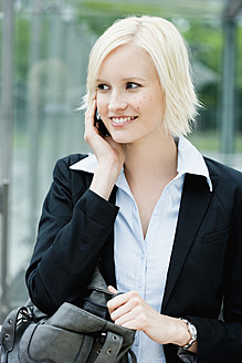 Germany, Bavaria, Munich, Young woman on phone, smiling - SPOF000029