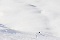 Austria, Zurs, Lech, Young man doing alpine skiing on Arlberg mountain - MIRF000289