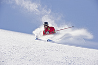 Austria, Zuers, Young man doing telemark skiing on Arlberg mountain - MIRF000340