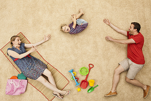 Germany, Family with toys at beach - BAEF000284