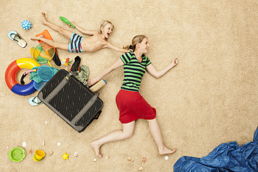 Germany, Mother and son with toys and baggage at beach - BAEF000296