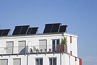 Germany, Cologne, Roof of residential building with solar panels - GWF001586