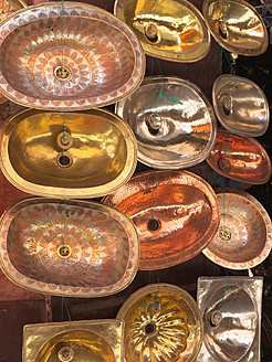 Morocco, Essaouira, Variety of copper wash bowls in shop at souk - BSCF000102
