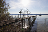 Germany, Bavaria, Upper Bavaria, Fuenfseenland, Breitbrunn, View of Lake Ammersee  with pier gate - SIEF001946