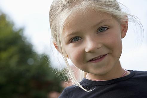 Germany, Bavaria, Huglfing, Girl in garden, smiling, portrait - RIMF000033