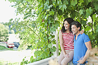 Germany, Bavaria, Couple in garden, smiling - WESTF017765