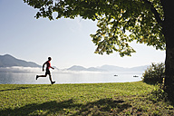 Germany, Bavaria, Walchensee, Mature man jogging - MIRF000353