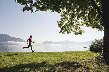 Germany, Bavaria, Walchensee, Mature man jogging - MIRF000353