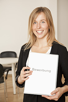Young woman holding folder with text - RIMF000051