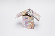 Model house of notes on white background - GWF001630