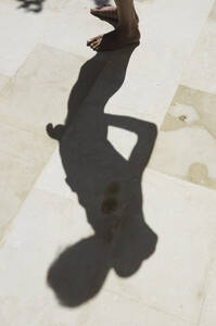 Greece, Ionian Islands, Ithaca, Shadow of mature man - MUF001144