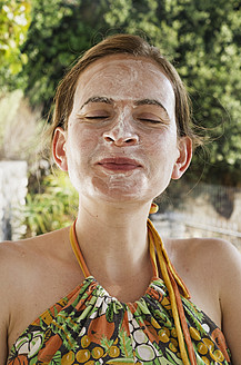 Greece, Ionian Islands, Ithaca, Mid adult woman in face treatment, smiling, close up - MUF001160