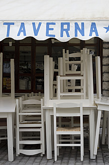 Greece, Ionian Islands, Ithaca, View of tavern with stack of chairs - MU001173