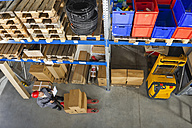Germany, Bavaria, Munich, Manual worker with clipboard in warehouse - WESTF018061