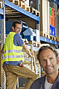 Germany, Bavaria, Munich, Manual workers working in warehouse - WESTF018070