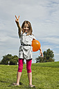 Germany, Bavaria, Girl playing in park with balloon, smiling, portrait - SKF000554