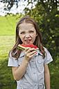Germany, Bavaria, Girl eating watermelon in park, portrait - SKF000560