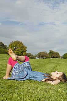Germany, Bavaria, Girl relaxing in park - SKF000563