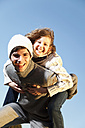Germany, Bavaria, Father and daughter having fun, smiling, portrait - MAEF003995