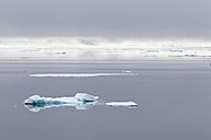 Europe, Norway, Spitsbergen, Svalbard, View of small iceberg on water - FOF003735