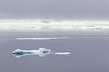Europe, Norway, Spitsbergen, Svalbard, View of small iceberg on water - FOF003735