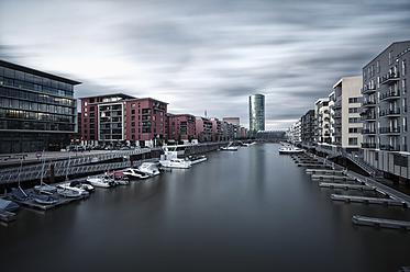 Germany, Hesse, Frankfurt, View of Westhafen harbor with city - WAF000004