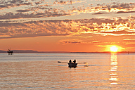 Germany, Baden-Wurttemberg, Langenargen, People in boat on Lake Constance at sunset - WDF001105