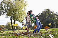 Germany, Cologne, Young couple in park, smiling, portrait - RHF000025