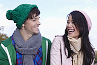 Germany, Cologne, Young couple smiling - RHF000031