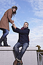 Germany, Cologne, Couple on bridge, smiling, portrait - RHF000040