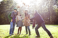 Germany, Cologne, Man and woman enjoying in park, smiling - RHF000055