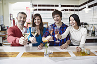 Germany, Cologne, Man and woman having wine, smiling, portrait - RHF000109