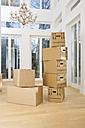 Germany, Bavaria, Grobenzell, Cardboard boxes in living room of house - WESTF018083
