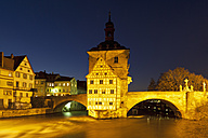Germany, Bavaria, Franconia, Bamberg, View of old city hall over Regnitz River at night - FOF003753