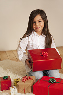 Girl with christmas present, smiling, portrait - RIMF000090