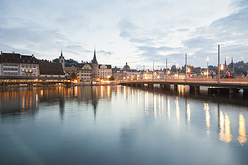 Switzerland, Lucerne, View of Schweizerhofquai Bridge with water tower and old town in morning light - MSF002499