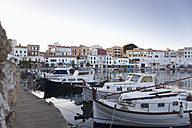 Spain, Menorca, View of harbour and old town of Es Castell in evening light - MSF002509