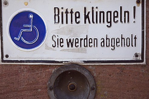Disabled sign on door with door bell, close up - MS002534