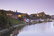 Germany, View of Saarburg on the river Saar at dusk - MSF002551