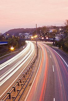 Germany, Saarbrucken, View of motorway with city at dusk - MSF002554