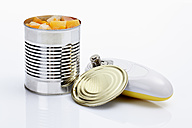 Tropical Fruit in tin with electric can opener on white background - CSF015492