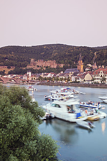 Germany, Heidelberg, People in boat on Neckar River with castle in background - MS002555