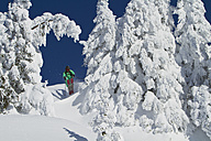 Austria, Tirol, Kitzbuehel, Man doing ski jumping - FFF001249