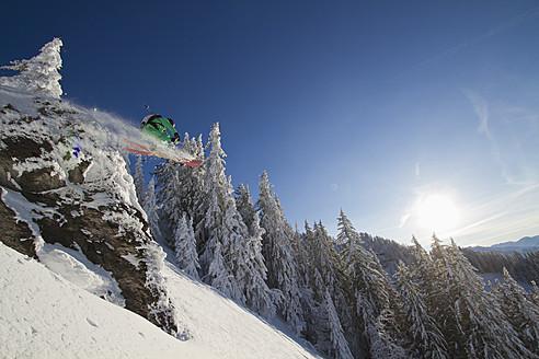 Austria, Tirol, Kitzbuehel, Man doing ski jumping - FFF001254
