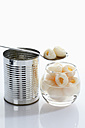 Lychee in glass bowl with tin can on white background - CSF015536