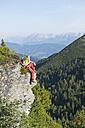Austria, Salzburg, Hiker sitting on rock, portrait - HHF003768