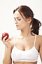 Young woman looking at apple - MAEF004104
