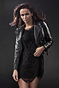 Young woman in black dress and leather jacket, portrait - MAEF004136