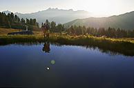 Austria, Salzburg, Couple watching sunrise - HHF003779