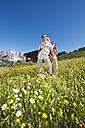 Austria, Salzburg, Filzmoos, Couple standing in alpine meadow - HHF003817